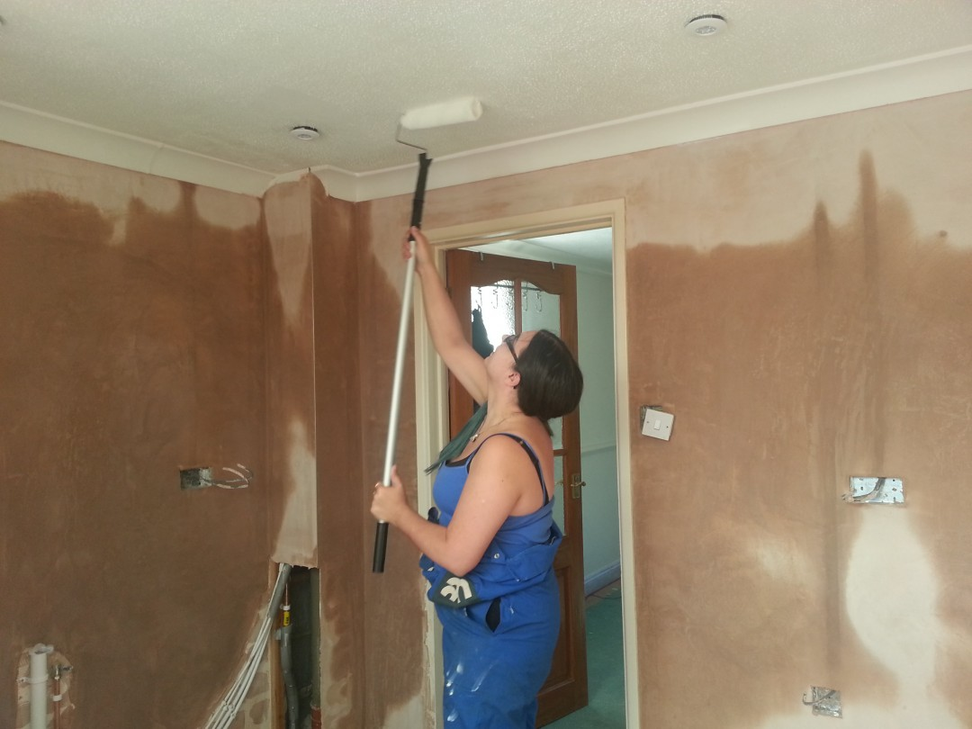 Carla attempting to paint a ceiling | carlawatkins.com