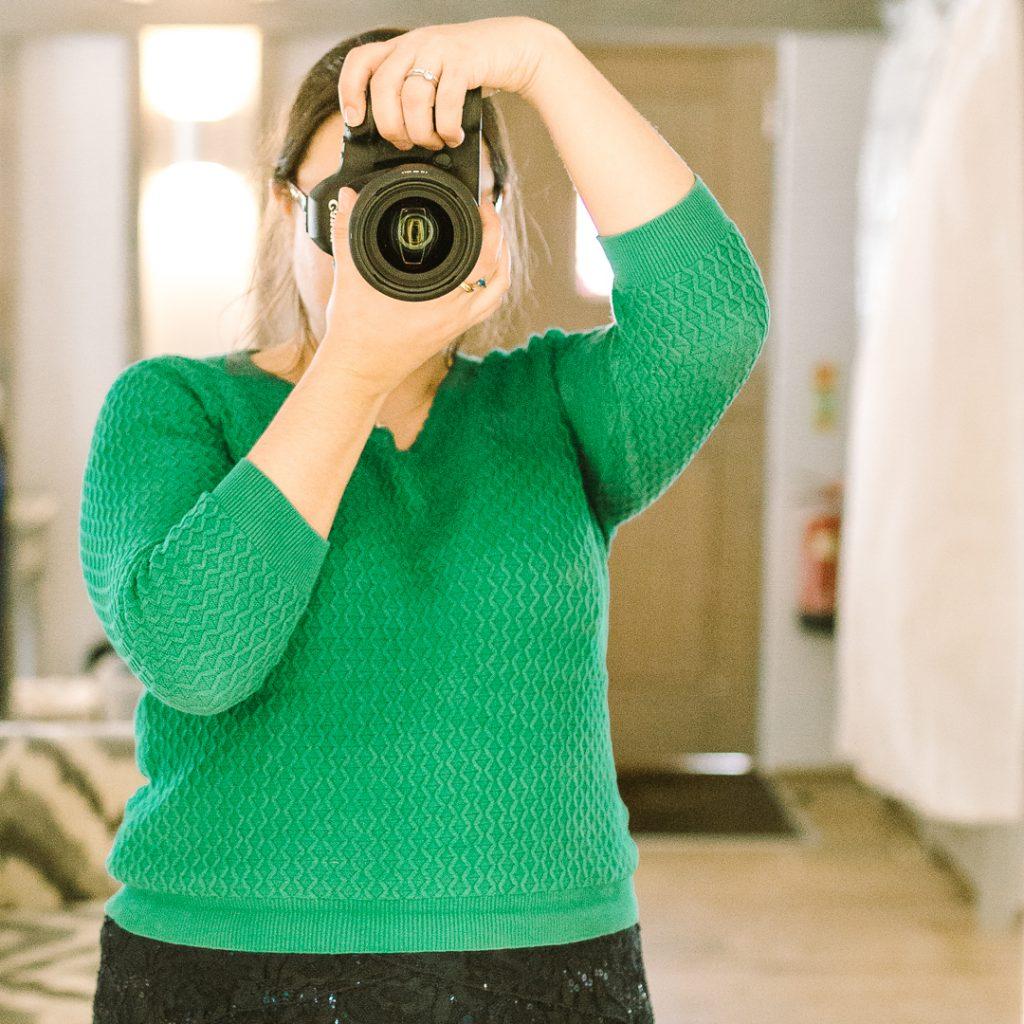 Carla taking a photo of herself in a mirror | carlawatkins.com