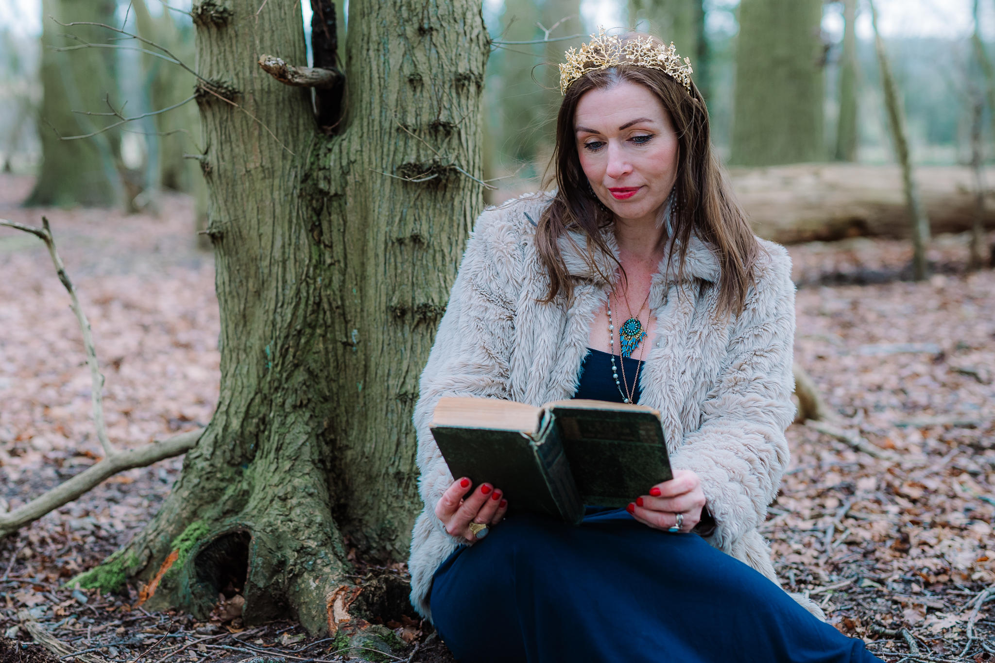 Fairytale personal brand photography, wild queen in the woods with a book - Lian of Waking the Wild